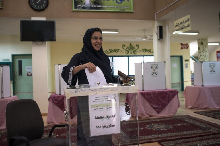Lama Suliman, a candidate for a municipal seat, enters her vote in the ballot box in North Jeddah. MONIQUE JAQUES FOR THE WALL STREET JOURNAL