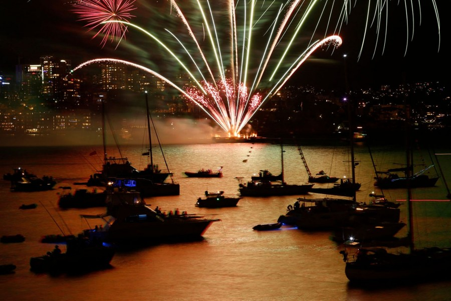 Fireworks-explode-over-boats-anchored-on-Sydney-Harbour-during-a-9pm-display-before-midnight-fireworks-usher-in-the-new