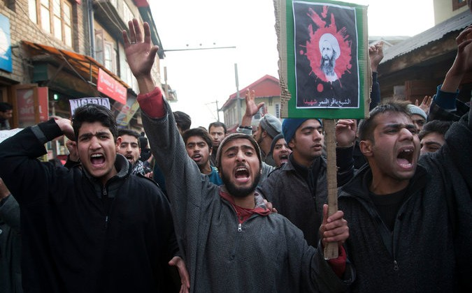 Shiites carrying a placard with an image of Sheikh Nimr al-Nimr at a protest in Srinagar, in the disputed region of Kashmir, on Saturday. Credit Dar Yasin/Associated Press