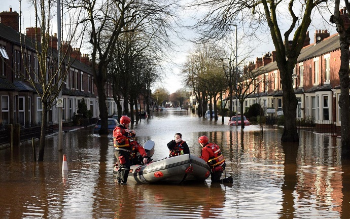 The emergency services prepare to rescue residents from a flooded street in Carlisle AFP/Getty
