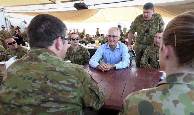 Australian Prime Minister Malcolm Turnbull has praised the international efforts by Australia Defence Force personnel during his visit to the Middle East, including talks with troops in Camp Bird in Iraq. (Reuters: Alex Ellinghausen)