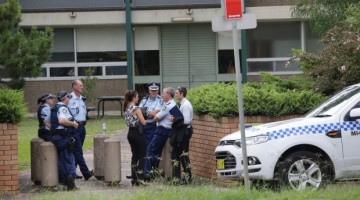 Police gather outside Woolooware High School, which received a bomb threat. Photo: John Veage