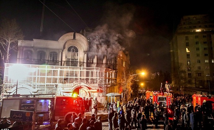 Firefighters arrive at the scene of the Saudi Arabian embassy which was torched by members of an angry mob in Tehran. Photo: EPA