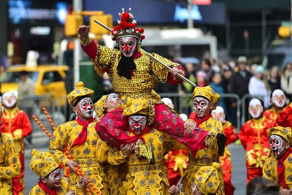 A flash mob featuring a hundred performers in monkey costumes makes an appearance to celebrate the arrival of the Chinese New Year in Times Square on Manhattan, New York, the United States, Feb. 6, 2016. (Xinhua/Wang Lei)