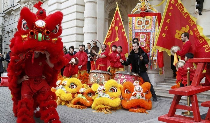 Members of the Pak Mei DE Lao Wei San Kung-Fu school perform to celebrate Chinese New Year in front of the Shangri-La hotel in Paris, France. (Reuters)