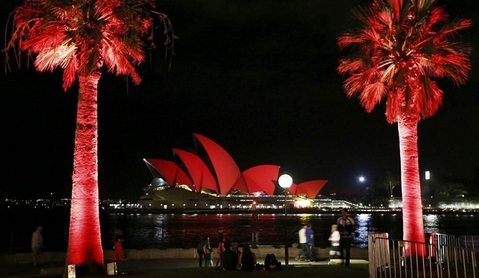 The Sydney Opera House is bathed in red light to mark the beginning of Lunar New Year celebrations.