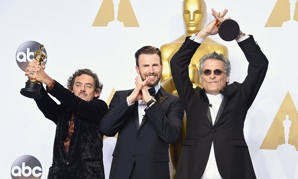 David White and Mark A Mangini, winners of the best sound editing award for Mad Max: Fury Road, with the actor Chris Evans (centre) Photo: Jason Merritt/Getty Images