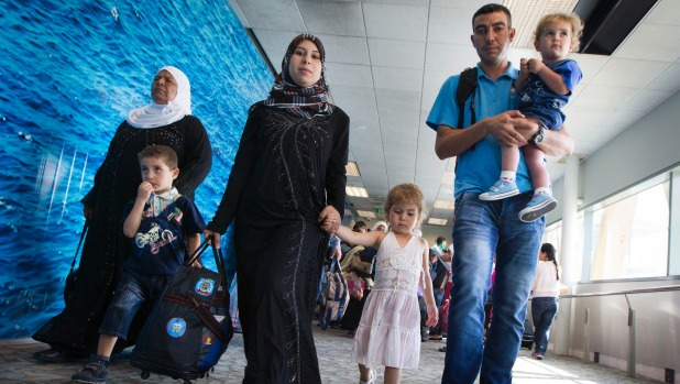 The Thani family arrived in Wellington on Friday to start their new life here. Rawad, 5, walks with his mum, Amena, and 3-year-old sister, Naba, while dad Wael carries son Salim, 2.