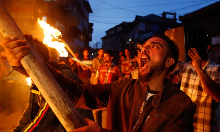 Activists of the Jammu and Kashmir Liberation Front (JKLF) shout slogans during a procession in Srinagar on April 18, 2015 | Mukhtar Khan, AP