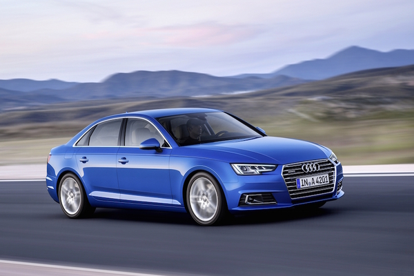 An Audi A4 in crystal effect paint finish Ara Blue is seen on the road. The 2017 Audi A4 upholds the strong tradition of its sports sedan predecessors.