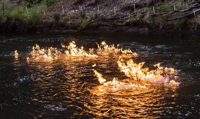 Australian Greens MP Jeremy Buckingham posted a video of himself lighting Queensland's Condamine River on fire. He blames a nearby fracking site. (Photo courtesy: Jeremy Buckingham)