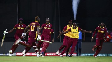 Andre Russell runs towards his team-mates after taking West Indies home, India v West Indies, World T20 2016, semi-final, Mumbai, March 31, 2016 ©Getty Images