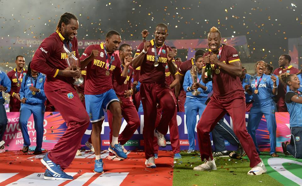 West Indies men's and women's players celebrate after their respective wins in the finals of the ICC World Twenty20 2016 cricket tournament at Eden Gardens in Kolkata, India, Sunday, April 3, 2016