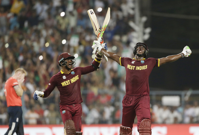 West Indies Carlos Brathwaite, right, celebrates with teammate Marlon Samuels after they defeated in England in the final of the ICC World Twenty20 2016 cricket tournament at Eden Gardens in Kolkata, India, Sunday, April 3, 2016. (AP Photo/Saurabh Das)