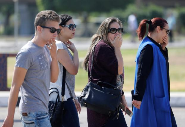 Unidentified relatives and friends of passengers who were flying in an EgyptAir plane that vanished from radar en route from Paris to Cairo react as they wait outside Cairo International Airport, Egypt. Photo: REUTERS/AMR ABDALLAH DALSH