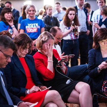 Supporters of the 'Stronger In' Campaign react as results of the EU referendum are announced at the Royal Festival Hall in London on June 24, 2016. ─ AFP