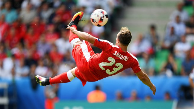 Xherdan Shaqiri of Switzerland scores their first goal during their UEFA EURO 2016 Round of 16 match against Poland