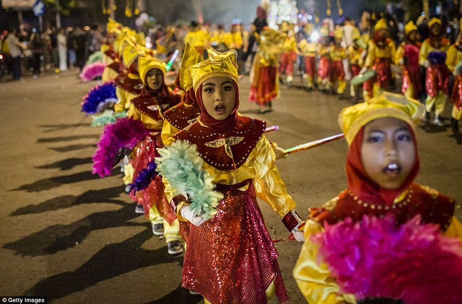 There were happier scenes in Yogyakarta, Indonesia, where children paraded through the streets to mark the end of Ramadan.