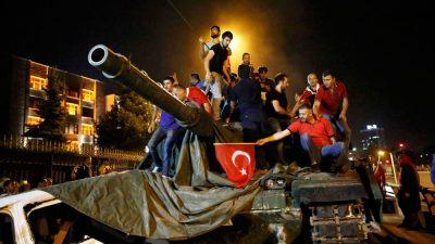 People stand on a Turkish army tank in the capital Ankara. Photo: Tumay Berkin/Reuters