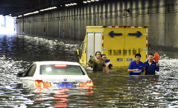 Hundreds of flights cancelled, train services suspended as Beijing, Tianjin lashed by torrential rain