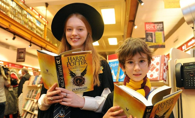 Annabelle Spence and Theo Bird were two of the first people to buy the new Harry Potter book in Sydney. Photo: Simon Bullard
