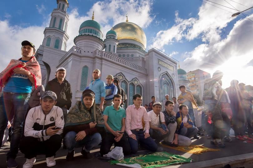 Muslims gather to offer prayers at the central mosque in Moscow on July 5, 2016, during celebrations for Eid al-Fitr marking the end of the Islamic holy month of Ramadan. Photo: Alexander Utkin/AFP/Getty Images