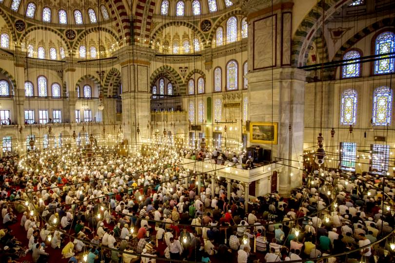 Turkish Muslims offer Eid al Fitr prayers as they mark the first day of the Eid al-Fitr at Fatih Sultan Mosque on July 5, 2016 in Istanbul. Photo: Chris McGrath/Getty Images