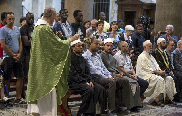 Muslims attend a Mass in Rome's Saint Mary in Trastevere church, Italy, Sunday, July 31, 2016. (Massimo Percossi/Ansa via AP)