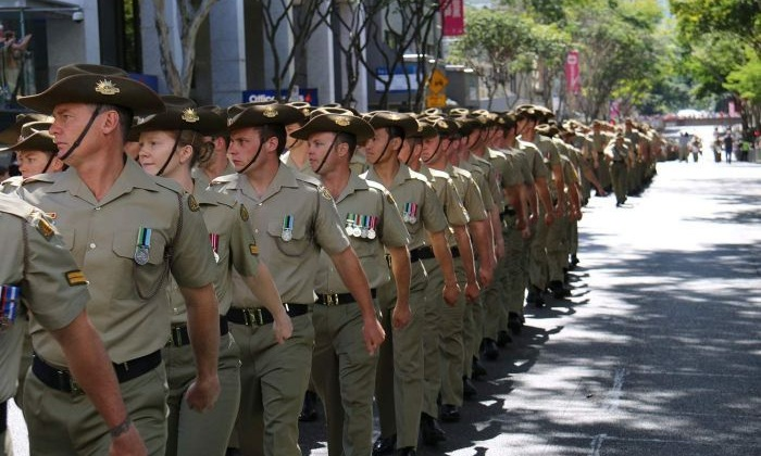 Australian soldiers from the 7th Brigade march through the centre of Brisbane as a formal welcome home from deployment in the Middle East. Photo: Matt Eaton/ABC News
