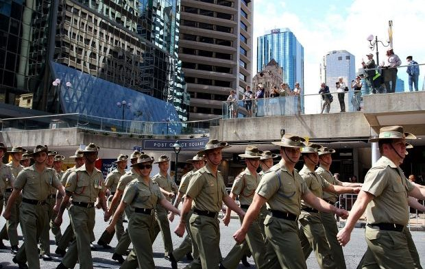 Members of the Australian Armed Forces march along Adelaide Street. Photo: Brisbane Times