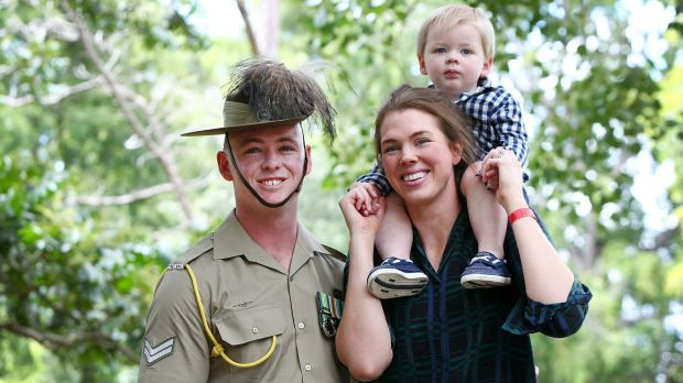 Australian Serviceman Corporal Tim McAllister of the 2/14 Light Horse Regiment with wife Olivia and two-year-old son Hamish after the Welcome Home Parade on Saturday morning. Photo: Lisa Maree Williams