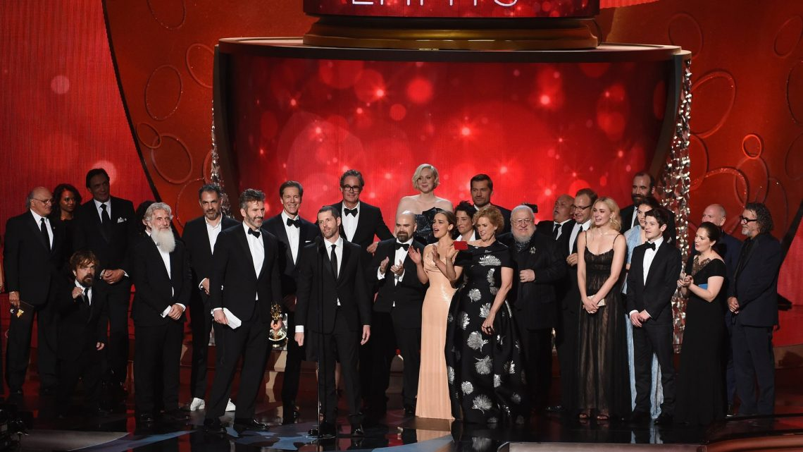 Writer/producers David Benioff and DB Weiss with production crew accept outstanding drama series for Game of Thrones. Photograph: Kevin Winter/Getty Images