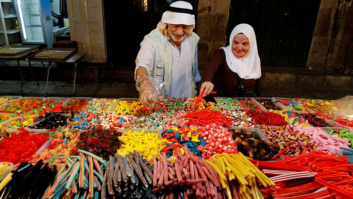 People buy sweets in Jerusalem's Old City before the Muslim holiday. Photo: Ammar Awad/Reuters