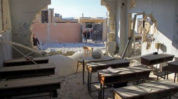 A school classroom was damaged and 22 students and six teachers killed in an air strike in rebel-held Idlib province. Photo: Omar Haj Kadour, AFP/Getty Images