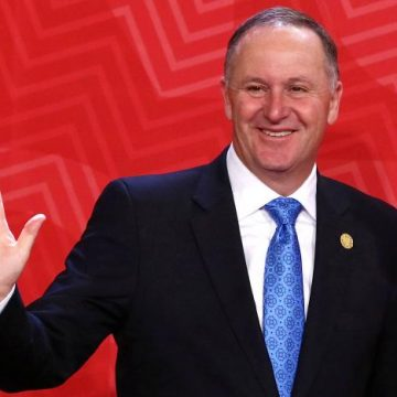 New Zealand's Prime Minister John Key waves to photographers during the APEC (Asia-Pacific Economic Cooperation) Summit in Lima, Peru, November 20, 2016. REUTERS/Mariana Bazo/File photo