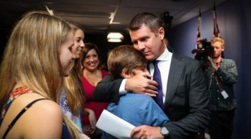 Premier Mike Baird embraces his family after the press conference announcing his resignation. Photo: Janie Barrett