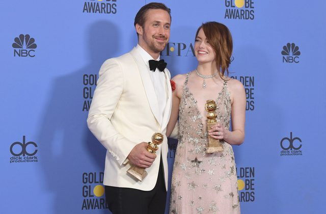 'La La Land' stars, Ryan Gosling and Emma Stone, with their awards at Golden Globes 2017