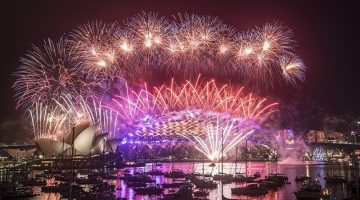 Pink, purple and orange fireworks explode over the Sydney Harbour Bridge and the Sydney Opera House