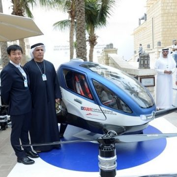 """The Dubai RTA chief Mattar Al Tayer with a representative of the Chinese driverless flying car, or AAV, maker Ehang. """"We are working hard to start operation of the AAV this July,"""" said Mr Al Tayyer. Courtesy APCO Worldwide"""