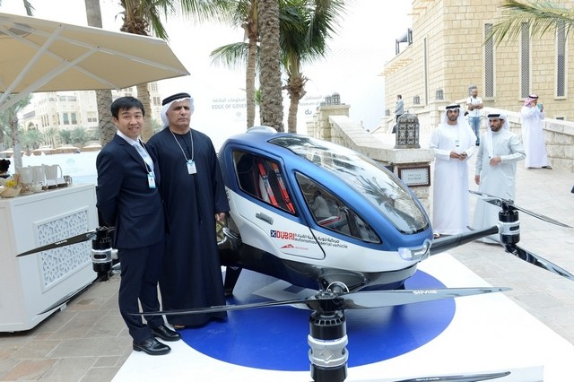 "The Dubai RTA chief Mattar Al Tayer with a representative of the Chinese driverless flying car, or AAV, maker Ehang. ""We are working hard to start operation of the AAV this July,"" said Mr Al Tayyer. Courtesy APCO Worldwide"