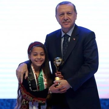 "Turkish President Recep Tayyip Erdogan (R) poses with Janna Jihad (L) after giving an award titled ""brave heart journalist"" to Jihad in Istanbul, Turkey on March 12, 2017. (Anadolu Agency )"