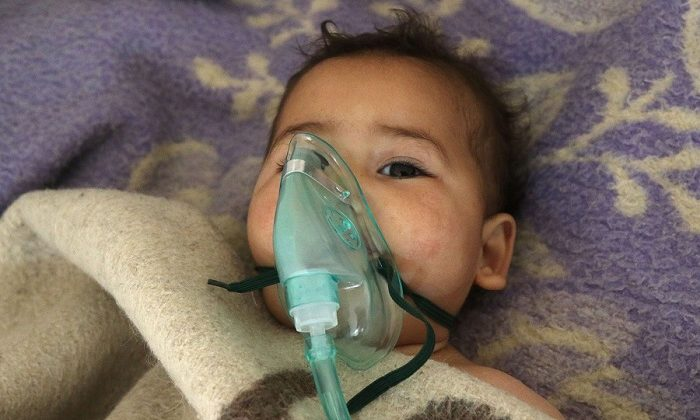 A Syrian child being treated following a suspected chemical attack in Syria
