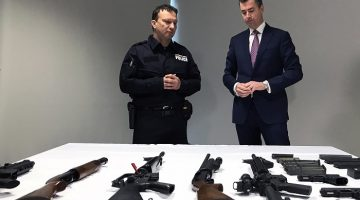 Justice Minister Michael Keenan (right) examines a range of weapons after announcing a new national gun amnesty in Canberra today. Picture: AAP