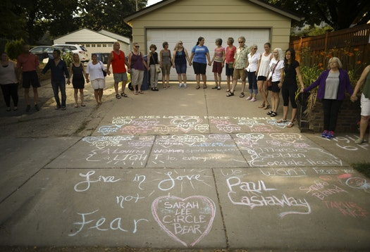 Friends and neighbors of Justine Damond held hands as a vigil to remember began Sunday evening.