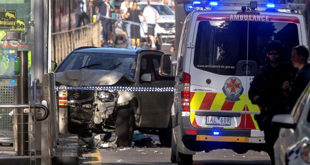 Australian police stand near a crashed vehicle after they arrested the driver of a vehicle that had ploughed into pedestrians at a crowded intersection near the Flinders Street train station in central Melbourne, Australia, December 21st, 2017. Photo: REUTERS/Luis Ascui