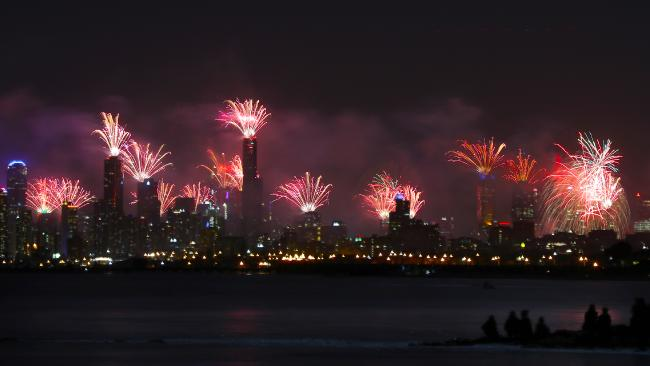 NYE Fireworks over Melbourne CBD from Green Point in Brighton. Picture: David Crosling. Source:News Corp Australia