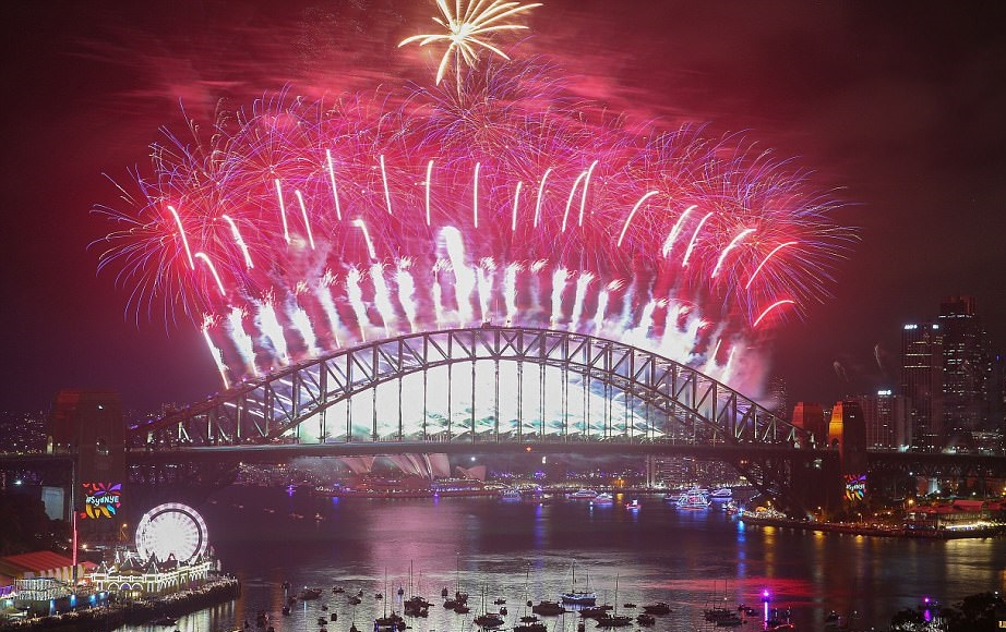 New Year's fireworks are seen above the Opera House and Harbour Bridge in Sydney, Australia. Over a million people gathered around the harbor to watch the 12-minute celebration for the start of 2018.