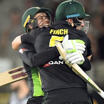 Alex Carey and Aaron Finch embrace to celebrate Australia's record-breaking victory. Photograph: Ross Setford/AAP
