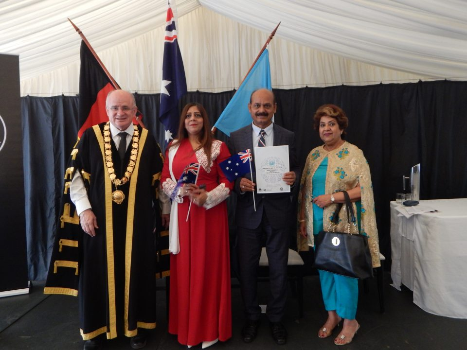 Syed-Atiq-ul-Hassan receiving Citizenship Award of the Year 2018 from Lord Mayor of Parramatta Surray Hassan in the middle and Kumand Mirani on Right December 18, 2017